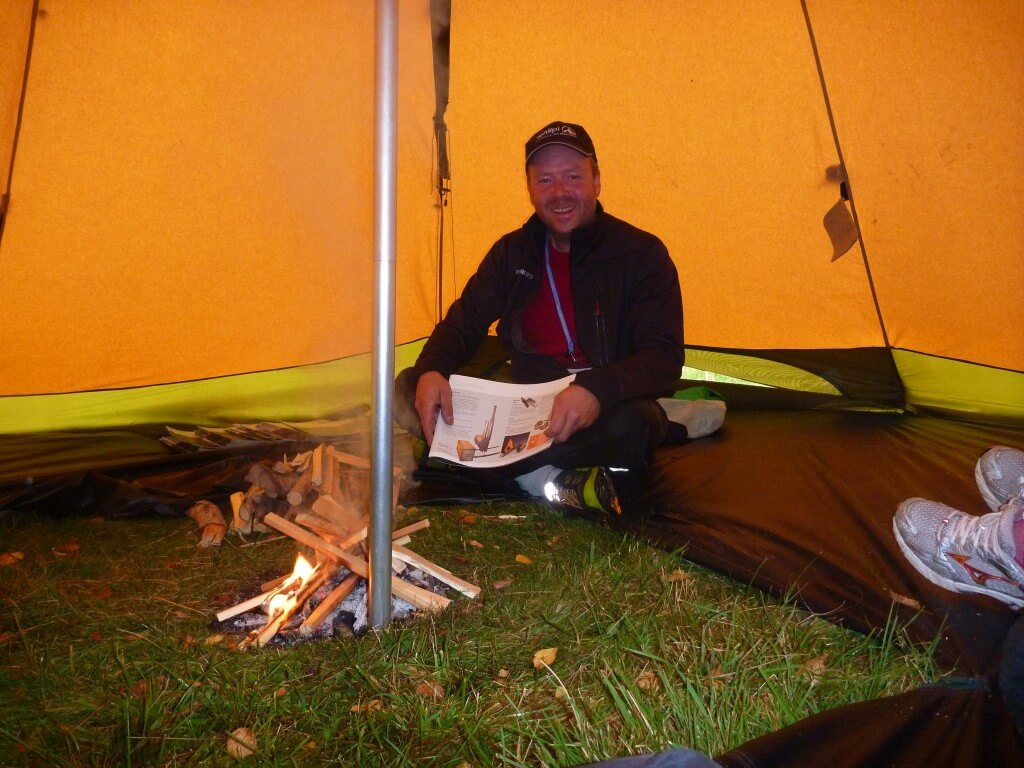 Patrick of Tentipi Tending the Fire in a Tentipi Safir 9 in Fjallbacka