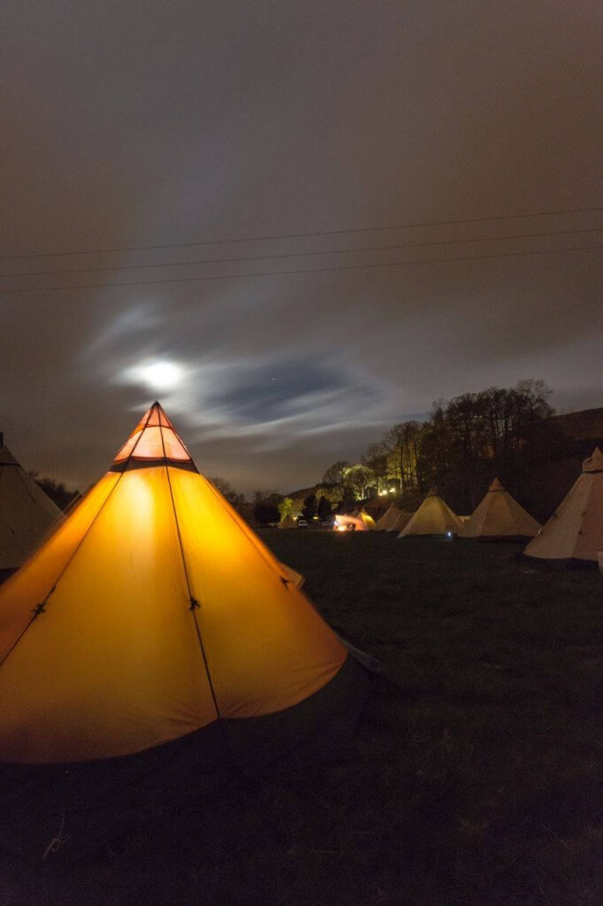 Tentipi Nordic Tipi night glow at a UK Tentipi Camp