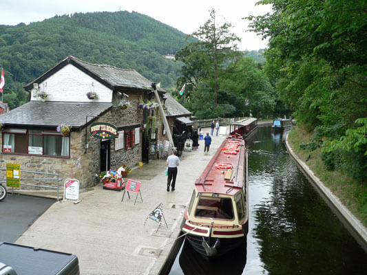Canoeing the Llangollen Canal Past the horse drawn boats at Llangollen Wharf