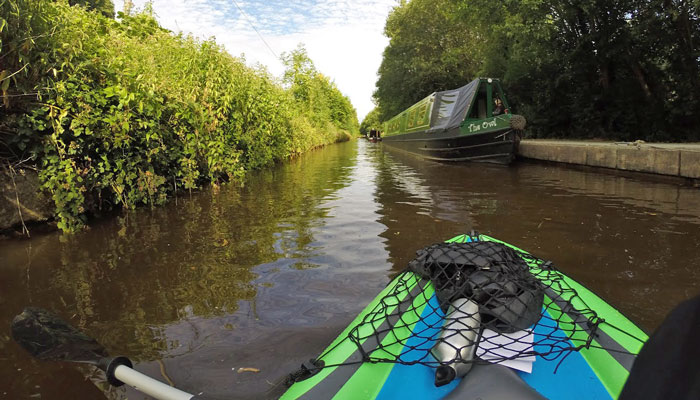 An inflatable kayak canoeing the Llangollen Canal